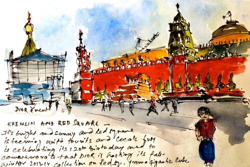 Leaning against a lightpost and sketching Kremlin and Red Square. The noise from the road repair just behind is turning me deaf.