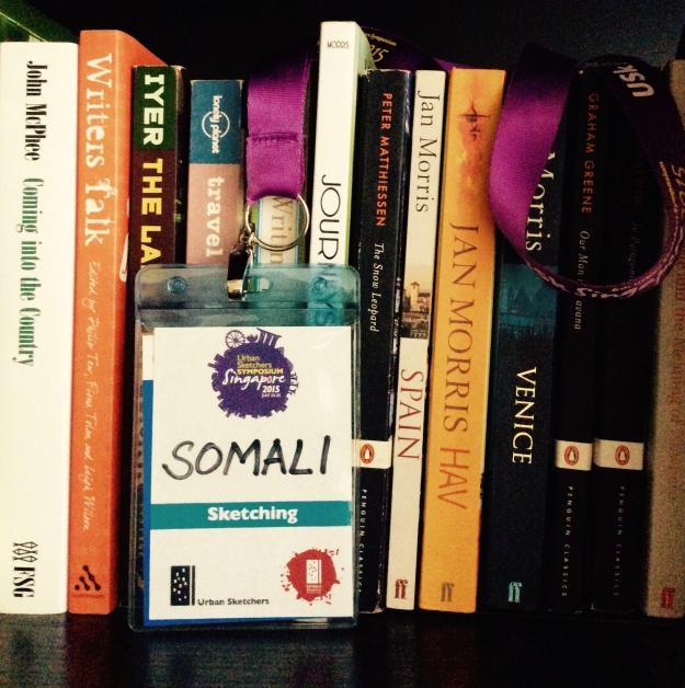 The Symposium name tag now decorates my bookshelf